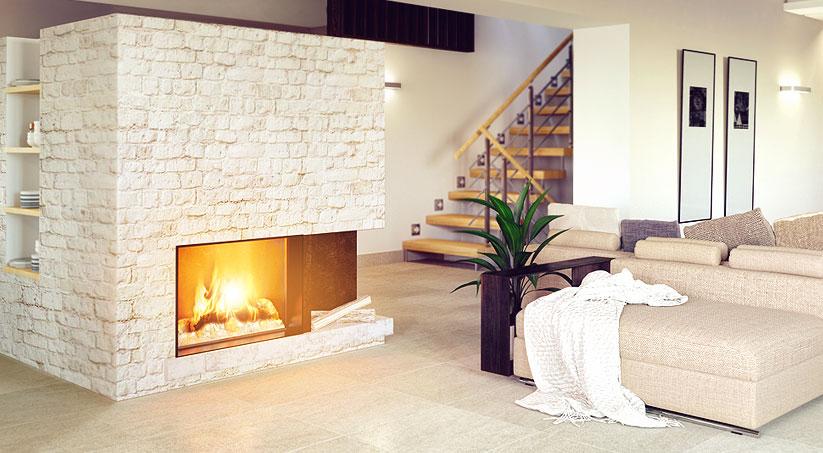 Przytulny i nowoczesny salon z kominkiem - ściana kominka wyłożona jest fototapetą imitującą jasną cegłę