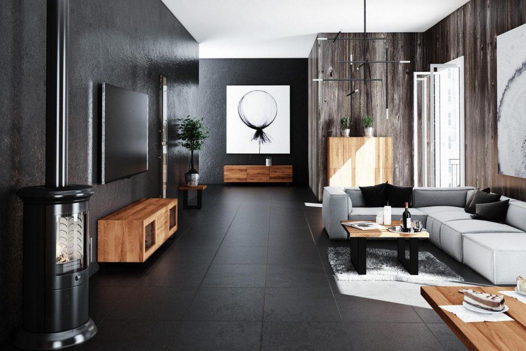 Chłód metalowych nóg kontrastuje z ciepłem drewnianych korpusów mebli i rustykalną ścianą.