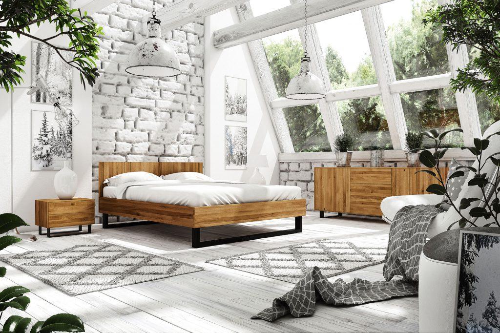 """Pomimo elementów typowych dla lokalu przemysłowego ta sypialnia zaskakuje przytulnością. Udało się to osiągnąć dzięki zastosowaniu drewnianych mebli i  """"ciepłych"""" tkanin."""