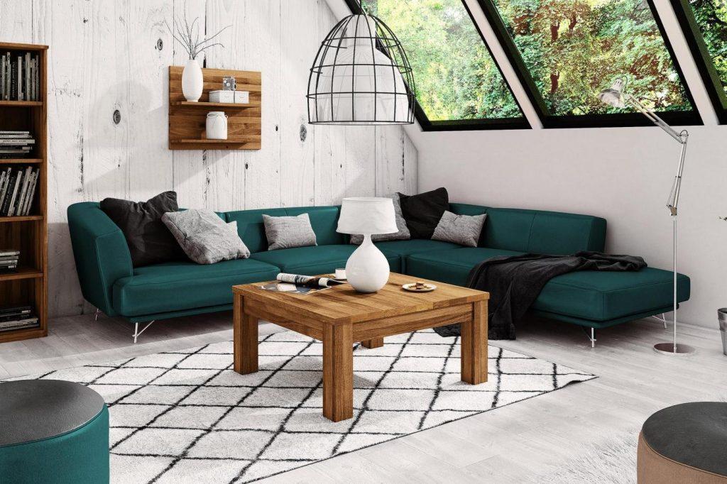 Nowoczesny salon z sofą w kolorze butelkowej zieleni